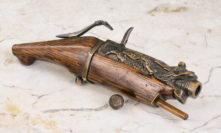 Antique Chinese 19th century matchlock pistol sometimes called a hand cannon.