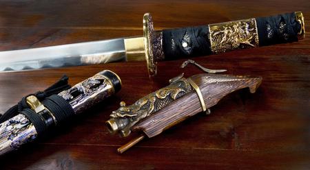 Antique Chinese matchlock pistol and Samurai sword.