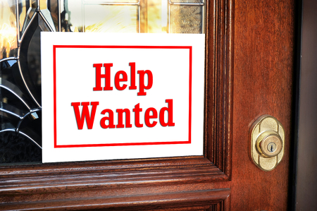 Help wanted sign on front door. Stock Photo