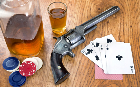 Dead mans hand aces and eights with Wild Bill's six shooter.