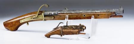 19th Century Japanese and Chinese Matchlock Pistols. Stock Photo