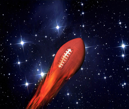 Football on fire with twliight showing in the sky. Stock Photo