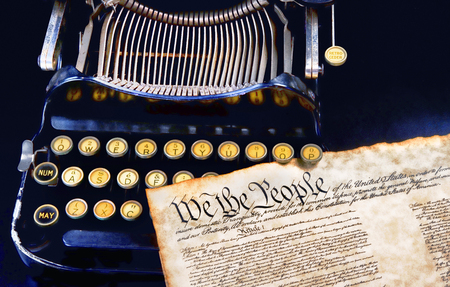 We the People preamble to the US Constitution on top of a antique typewritter. Stock Photo