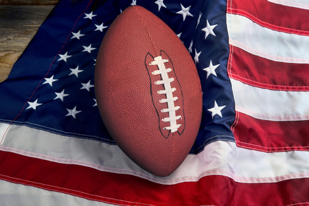 American football on American flag, old glory.