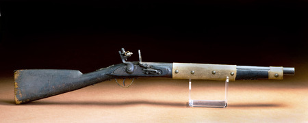 American flintlock rifle made around 1840 and used by American Indians with buffalo hide repair.