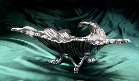 Antique English sterling silver shell dish with dolphin feet made around 1890.