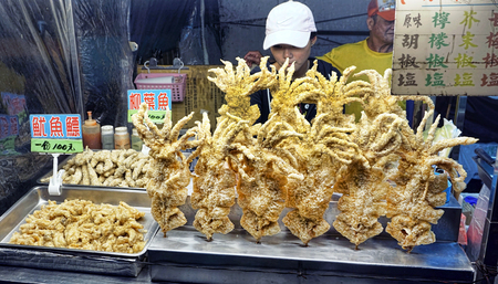 Taipei, Taiwan - Dec. 8,2018  Fresh fried squid at popular night market in Taiwan. Editorial
