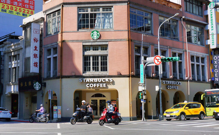 Taipei, Taiwan -  Nov. 30, 2018 -  Popular three story Starbucks in downtown Taipei. The store is always busy with many local customers.