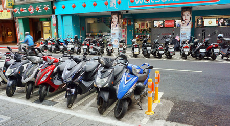 Taipei,Taiwan - Dec. 7,2018 - Typical street in Taipei with an estimated 13 million motorbikes in Taiwan with only a population of 23 million people