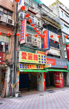 Taipei, Taiwan - Dec.2,2018 - A typical doentown street in Taipei, the store owner runs the shop on the street and lives in the above floors of their apartment. Editorial