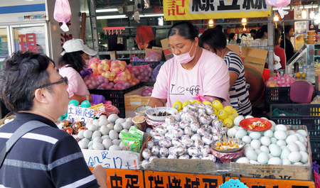 Hengchun, Taiwan - Dec.8, 2018 - Bussy egg lady selling fresh eggs in the Hengchun food court. Editorial