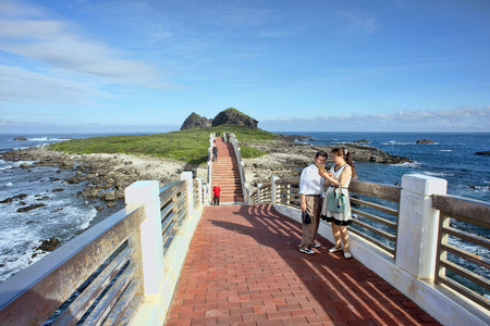 Taitung,Taiwan - Dec.5,2018 - Sanxiantai Dragon Bridge with tourist walking to the Sanxiantai Island. Sanxiantai means platform of the three immortals.