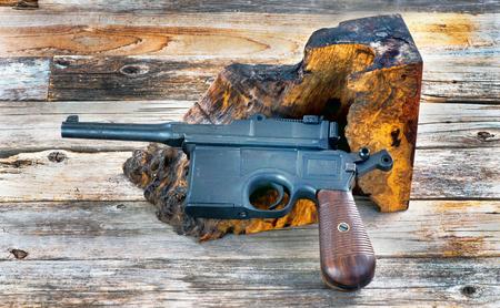 Antique German Broomhandle pistol made around 1926. Stok Fotoğraf - 119828034
