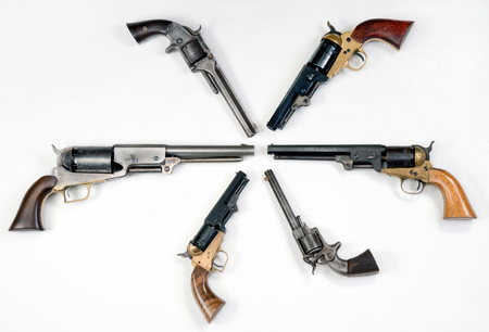 Antique western pistols of the old wild west. 免版税图像