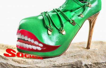 Green monster shoe stepping on the new Socialism. Stock Photo