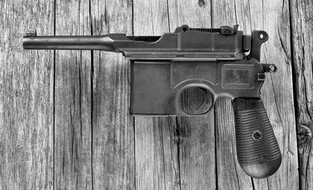 Antique German broomhandle pistol made around 1926 in black and white.