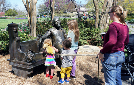 Dallas,Texas- March 18,2019 - Young family of kids looking at a Shakespeare in the park on a nice Spring day at the Dallas Abboretum Garden. Editorial
