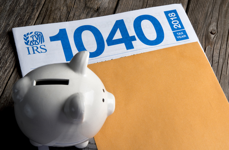 File your 1040 IRS before April 15th. Stock Photo