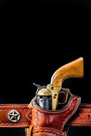 Antique western cowboy pistol in holster with room for your tyoe.