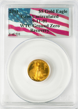 Dallas, Texas - April 12,2019 - A 2001 Gold  Eagle coin recovered from the rubble of the World Trade Center 911 Ground Zero in the basement of Tower One in New York City.