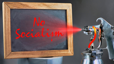 No Socialism spray painting on blackboard.
