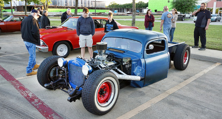 Kennedale,Texas - April 19,2019  Friday night classic car and hot rod show in Kennedale,Texas with people looking at a very low rider truck..
