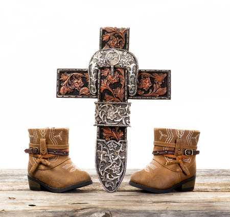 Cowboy prayer cross and cute pair of cowboy boots . Stock Photo