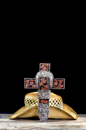 Cowboy prayer cross and old stray hat with room for your type.