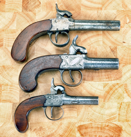 Three antique muff percussion pistols made around 1850.