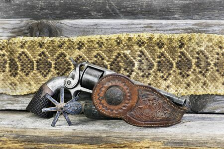 Antique side hammer pistol with Mexican spur and Texas Rattlesnake skin.