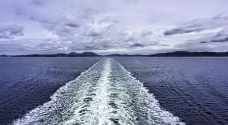 Water wake behind speed boat in Canada will make for great background graphic.