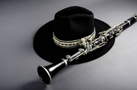 Clarinet and black jazz hat with room for your type. Imagens