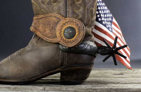 Cowboy glory with American flag and spurs.
