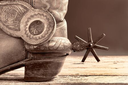 Cowboy boots and  Mexican spurs in black and white sepia tone with room for your type. Imagens