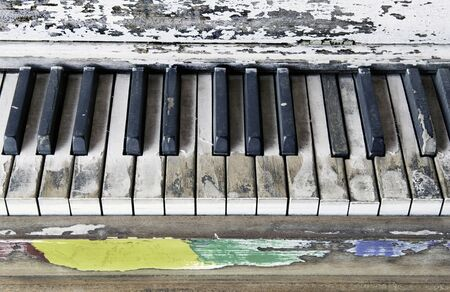 Old  piano keys that have seen a lot of action. Imagens