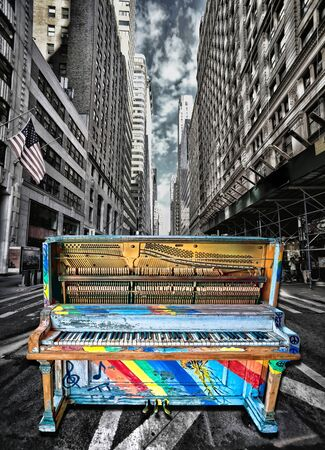 Surreal old painted up jazz piano on downtown busy street.