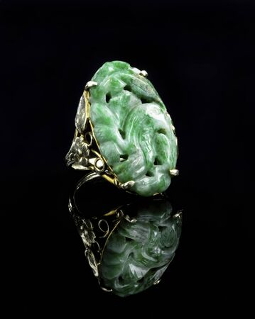 Burmese imperial green carved  jadeite gold ring.