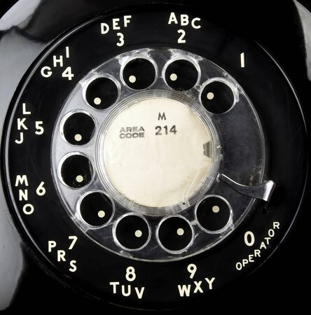 Closeup of old rotary telephone dial used in the 1960s.