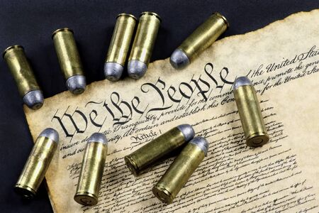 We the People and 45 cartridge bullets. Imagens