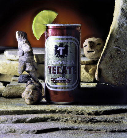 Dallas,Texas - Oct.13,2019 - Cold Tecate beer with Mexican Pre Columbian figures. Editorial