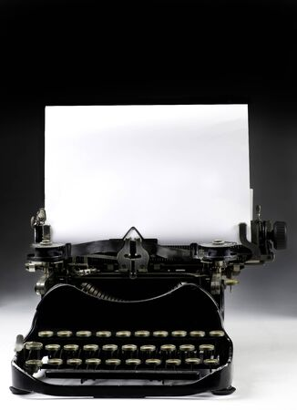 Antique typewritter with blank page to put your type or text on.