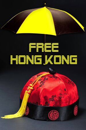 Free Hong Kong pro-independence movement with Chinese silk hat. Imagens
