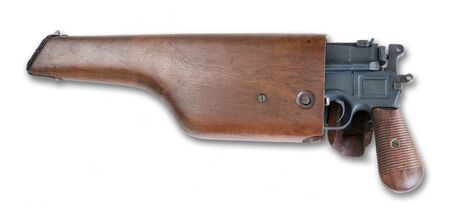 Antique German broomhandle pistol made around 1926 inside the wooden shoulder stock storage compartment.