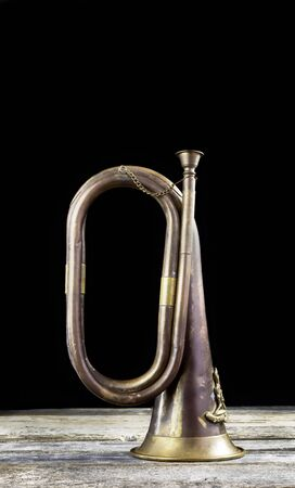 Old brass bugle with room for your type and message.