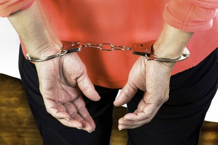 Woman in steel handcuffs after arrest.