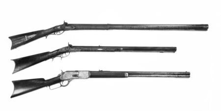 Antiques rifles,full stock,half stock and cowboy repeating rifle in black and white.. Made from 1840 to 1876.
