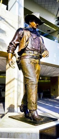 Orange County, Califorina , May ,2010 -  On June 20, 1979, the Orange County Board of Supervisors renamed Orange County Airport to John Wayne Airport. Showing a life size bronze statue of John Wayne  the Duke .