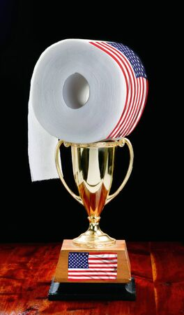 Last roll of toilet paper award with gold trophy and old glory..