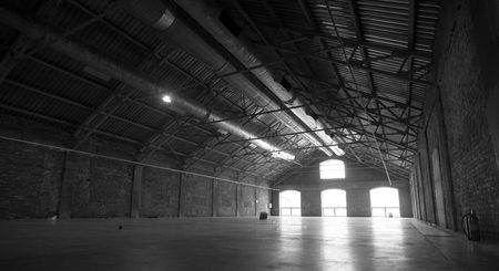 Large empty hangar with light going through the windows