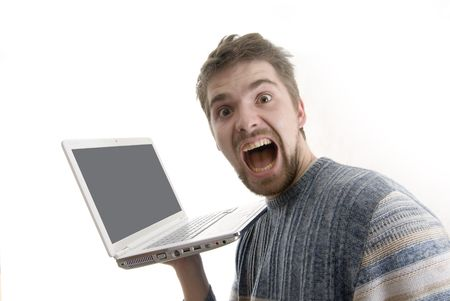 Young man with white laptop screaming. Laptop screen was cleaned up for your text or image. Stock Photo - 5303564